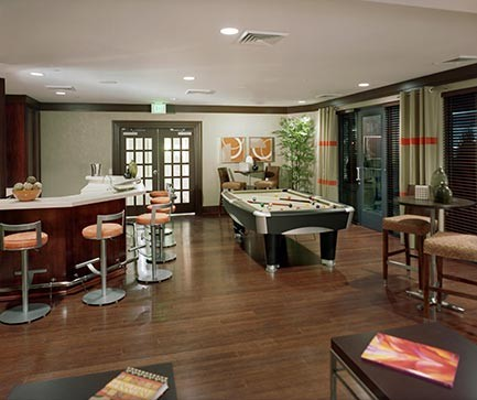 View of Palladian clubroom with billiards and bar area